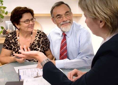 Senior couple meeting with a will and estate planning attorney.